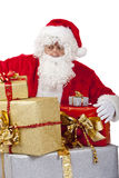 Surprised Santa Claus with Christmas gifts Stock Photos