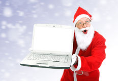 Surprised Santa Claus with Laptop Royalty Free Stock Photos