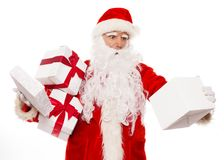 Surprised Santa Claus with opened gift box Stock Photo