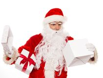Surprised Santa Claus with opened gift box Stock Images