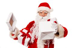 Surprised Santa Claus with opened gift box Stock Photography