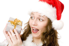 Surprised Santa Claus woman holds Christmas gift Stock Photos