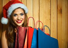 Surprised Santa girl hold shopping bag. Royalty Free Stock Photo