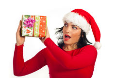 Surprised Santa helper holding present Stock Image