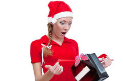 Surprised Santa helper looking into present box Royalty Free Stock Images