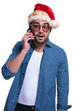 Surprised santa man talking on the phone Stock Photo