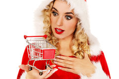 Surprised santa woman holding a small trolley Royalty Free Stock Photos