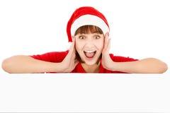 Surprised Santa woman leaning on billboard royalty free stock image