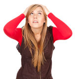 Surprised, scared girl looking up,. Surprised, scared young woman looking up, white background Stock Image