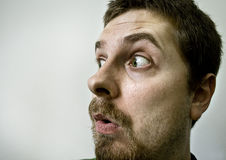 Surprised and scared spooky man. Funny guy with a surprised expression on his face Royalty Free Stock Photography