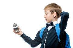 surprised schoolboy watching time on alarm clock, portrait isola Royalty Free Stock Photos