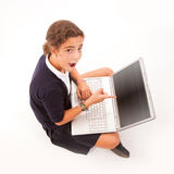 Surprised schoolgirl with laptop Stock Image