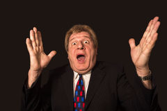The surprised senior businessman on black Stock Image