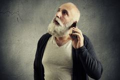 Surprised senior man with cellphone Stock Photography