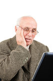 Surprised senior man looking at PC screen Royalty Free Stock Images