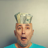 Surprised senior man with money Royalty Free Stock Photo