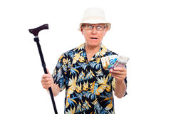 Surprised senior with money Stock Image