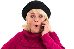 Surprised senior woman holding cellphone. Stock Photography