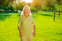 Surprised senior woman. Lady with open mouth. Didn't expect such a turn. One moment changes everything stock photos