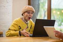Surprised senior woman and laptop. Royalty Free Stock Photos