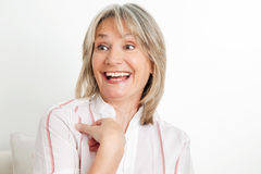 Surprised senior woman laughing Royalty Free Stock Photo