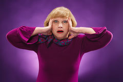 The surprised senior woman Stock Photography