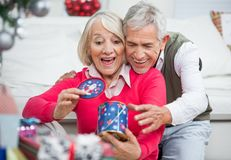 Surprised Senior Woman With Man Looking At Stock Photos