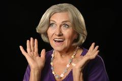 Surprised senior woman Stock Photos