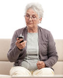 Surprised senior woman talking at cellphone Stock Images