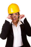 Surprised sexy businesswoman with helmet Stock Photo