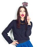 Surprised sexy model girl holding funny crown on stick. Isolated on white Royalty Free Stock Photos