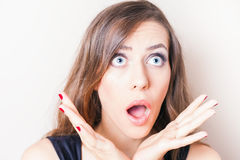 Surprised and shocked beautiful woman looking up Stock Photography