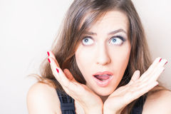 Surprised and shocked beautiful woman looking up Royalty Free Stock Photos