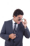Surprised and shocked businessman with glasses holding keys Stock Photo