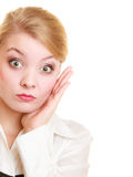 Surprised shocked businesswoman woman girl. Emotions. Portrait of surprised businesswoman boss shocked blond woman clutching head of surprise isolated on white stock image