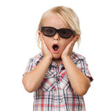 Surprised shocked cute child. A surprised shocked and scared cute little boy wearing 3D glasses. Isolated on white Royalty Free Stock Photography