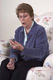 Surprised Shocked Grandma Texting on Cell Phone Stock Photography