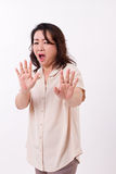 Surprised, shocked, stunned middle age woman Stock Photos