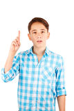 Surprised or shocked teen boy in plaid shirt staring at camera and keeping arm up isolated on white Royalty Free Stock Photography