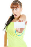 Surprised and shocked woman showing empty blank paper card sign. Gift card , excited cute surprised and shocked woman or teenager girl showing empty blank paper Royalty Free Stock Photography