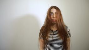 Surprised and shocked young caucasian woman with long red hair stock video footage