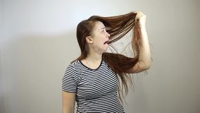 Surprised and shocked young Caucasian woman with long red hair stock footage