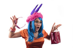 Surprised shopaholic. A shopping girl shocked probably about the low prices that she saw Royalty Free Stock Photo