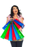 Surprised shopper woman looking up. And holding colorful shopping bags isolated on white background Stock Photos