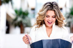 Surprised shopping woman Stock Photography