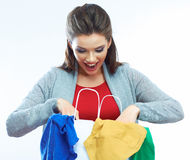Surprised shopping woman. Surprised woman. Loocking in shoping bag Stock Images