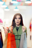 Surprised Shopping Woman Wearing a Green Coat in Fashion Store Stock Images