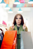 Surprised Shopping Woman Wearing a Green Coat in Fashion Store Royalty Free Stock Image