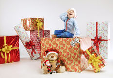 Surprised small santa on the presents Stock Photography