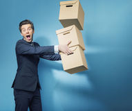 Surprised smart banker with the boxes Royalty Free Stock Image
